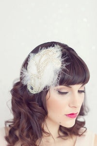 Image of feather headband with rhinestone design