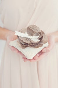 Image of Burlap ring bearer pillow topped with handmade silk flower