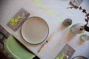 Image of Nearly White linen tablecloth with Citron yellow arrows