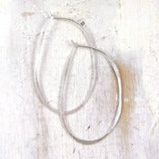 Image of silver oval hoop