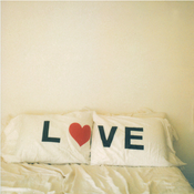 Image of love up on those pillows