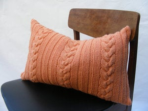 Image of Hand Knit Cushion 50 x 30cm - tangerine knotted cable