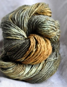 Image of whisper of the forest's sun. gliding yarn. merino/silk worsted.