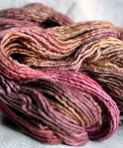 Image of tea steeped roses. gliding yarn. merino/silk worsted weight.