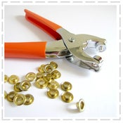 Image of Eyelet Pliers with 100 eyelets included.