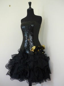 Image of black sequined party dress w/ ruffled skirt