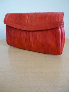 Image of cherry red eelskin clutch handbag