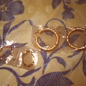 Image of Two pairs of golden hoop earrings 