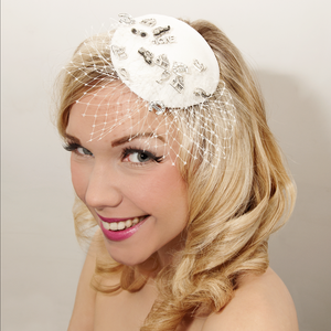Image of Bridal veiled fascinator, decorated with wedding themed charms.