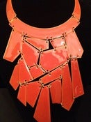 Image of Orange puzzle piece necklace