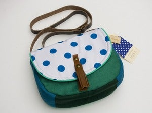 Image of --S O L D -- a small cross body bag with a white and royal blue polka dot flap
