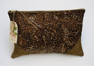 Image of -- S O L D -- an oversized clutch in leopard print with leather corners