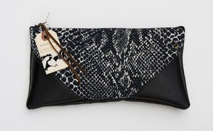 Image of --S O L D -- black + white snake print clutch with black leather corners