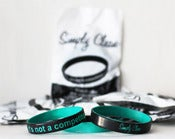 Image of 2 Tone Black/Teal &quot;it's not a competition&quot; Wristband