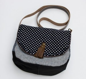 Image of -- S OL D O U T -- a small cross body bag with a black + white polka dot flap