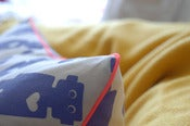 Image of girlbot Pillow with piping