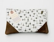 Image of large charcoal + cream brushstroke crosses print clutch with leather corners