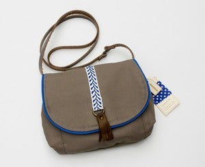 Image of --S OL D O U T -- small cross-body bag in taupe with royal + white woven trim and leather tassel