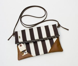 Image of - SOLD OUT- a foldover clutch in chocolate + vanilla stripe with a removable strap!