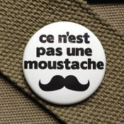 Image of this is not a mustache homage button