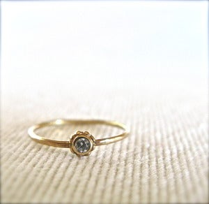 Image of beaded 14k gold and diamond solitare ring