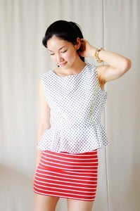 Image of Black Polk-a-dot Peplum Top with Neon Piping