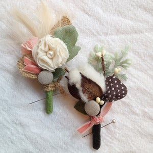 Image of cotton or feather boutonniere