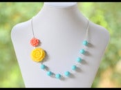 Image of Yellow Rose and Coral Daisy Flower in Turquoise Chunky Asymmetrical Statement Necklace - NA042