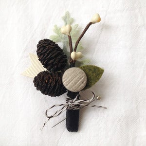 Image of pine cone boutonniere