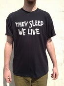 Image of INVADA 'they sleep we live' BLACK T-SHIRT front & back print