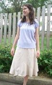 Image of Gauze-knit Raglan TopAnd tan skirt