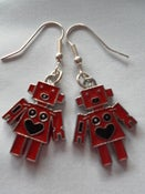 Image of Metal Red Robot Earrings with Heart Shaped Smiley Face Detail