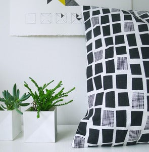 Image of city windows cushion in black and white