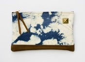 Image of zipper clutch in hand bleached denim 
