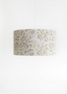 Image of cross dotty mustard and steel shade