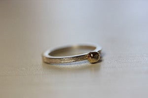 Image of single driftwood stacking ring with gold/diamond pebble