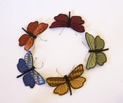 Image of Textile Moth Brooch / Ornament Velvet Upholstery Fabric