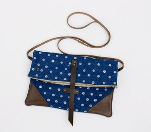 Image of foldover crossbody bag in vintage denim with hand-stamped polka dots