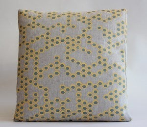 Image of reworked hex butter/sage cushion