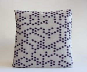 Image of reworked hex lilac/charcoal cushion