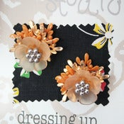 View 1950s flower earrings