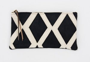 Image of a large black + white hand painted diamonds zip clutch with a METAL zipper