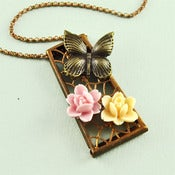 Image of Copper Tone Keystone Filigree Butterfly Necklace with Cream and Pink Flowers