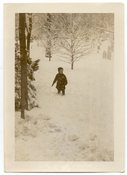 Image of BOY IN THE SNOW GRAVE YARD IN THE BACKGROUND VINTAGE SNAPSHOT PHOTO