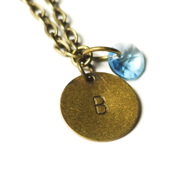 Image of march initial necklace - antiqued brass