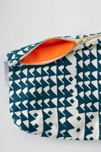 Image of limited edition NEON ORANGE & AQUA zippered pouch