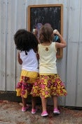 Image of Girls pink and yellow ruffle skirt sz 3-7yrs!