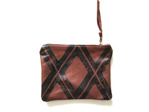 Image of Small brown/black Xs hand-printed leather pouch