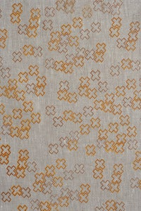 Image of cross dotty mandarin and burnt tangelo linen