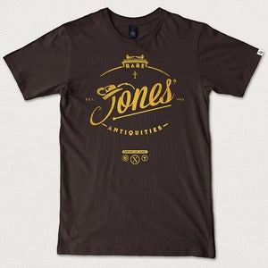 "Image of ""Jones' Rare Antiquities"" - Dark Chocolate tee gold print"